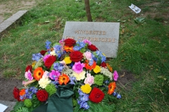 Flowers placed at the Memorial Stone, under the Remembrance Tree
